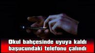 OKUL BAHÇESİNDE UYUYA KALDI BAŞUCUNDAKİ TELEFONU ÇALINDI